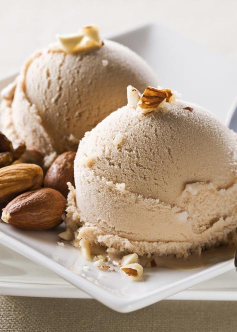 Fresh hazelnut ice cream on plate close up